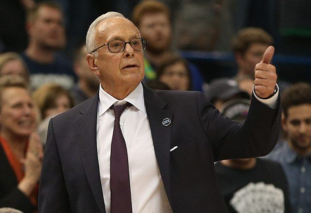 "Larry Brown gesturing a ""thumbs up"" during a basketball game."