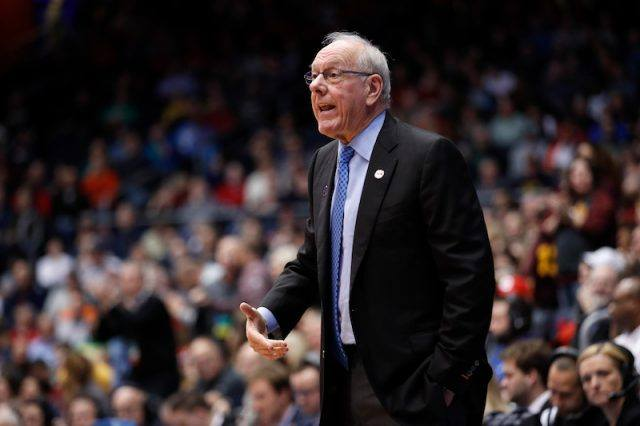 Jim Boeheim standing in a basketball court during a game.