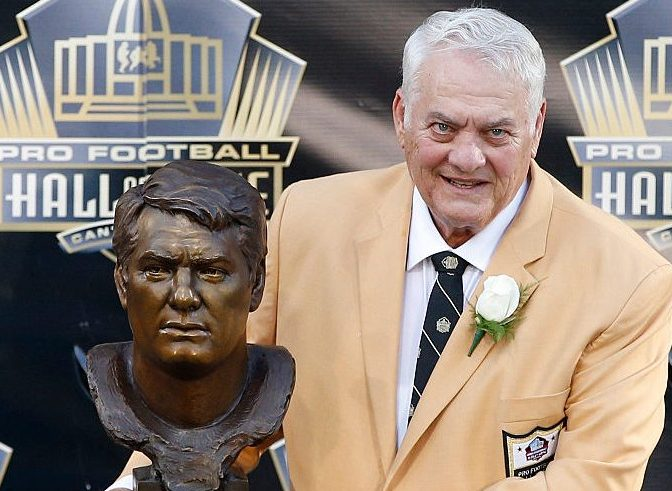 Mick Tingelhoff poses with his bust during the NFL Hall of Fame induction ceremony