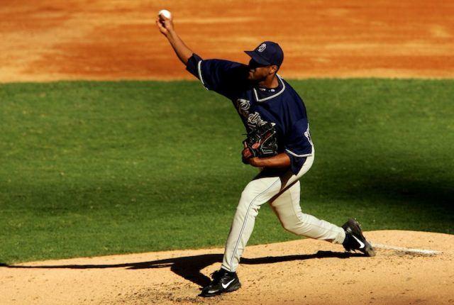 Pedro Astacio throwing a baseball on the field.