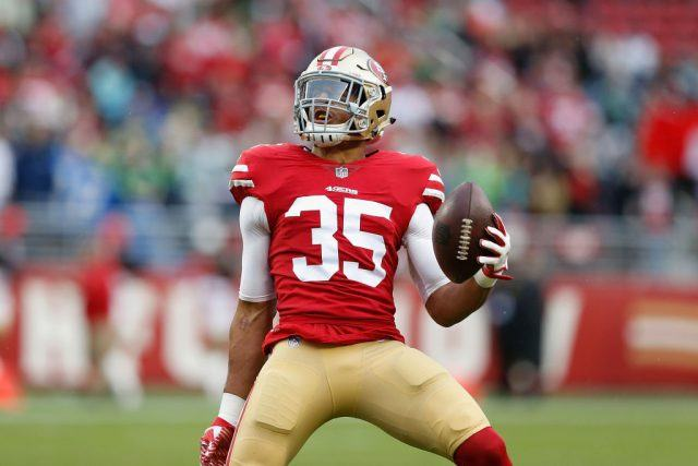 Eric Reid #35 celebrates after intercepting a pass against the Seattle Seahawks
