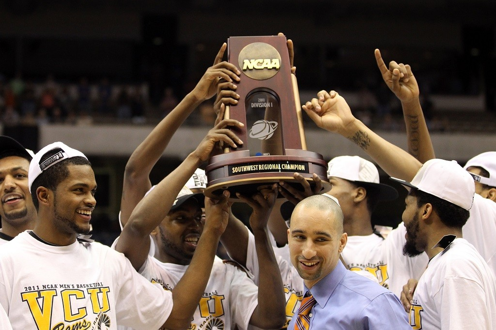 Head coach Shaka Smart of the Virginia Commonwealth Rams celebrates after defeating the Kansas Jayhawks.