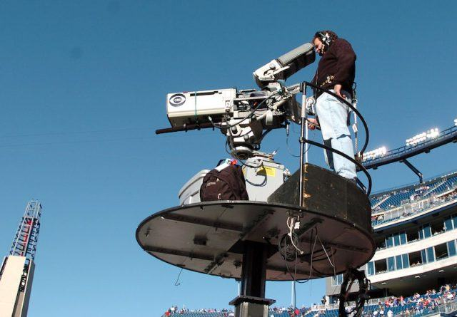 A CBS cameraman recording a football game.