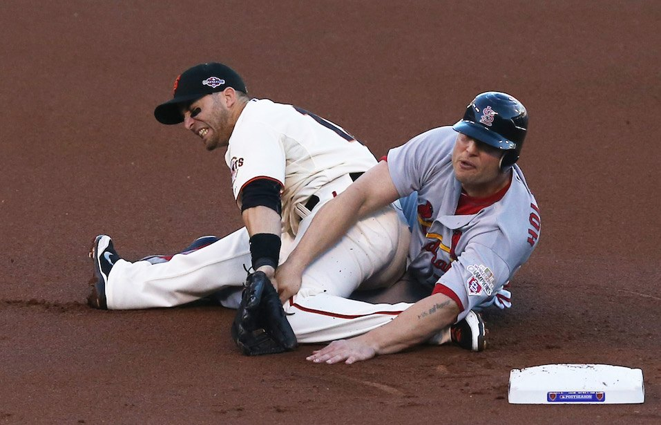 Matt Holliday #7 of the St. Louis Cardinals slides into second knocking over Marco Scutaro #19 of the San Francisco Giants