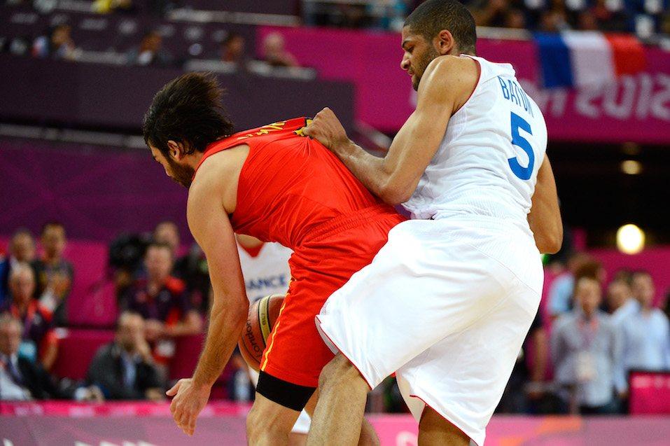 Nicolas Batum #5 of France fouls Juan-Carlos Navarro #7 of Spain late in the fourth quarter