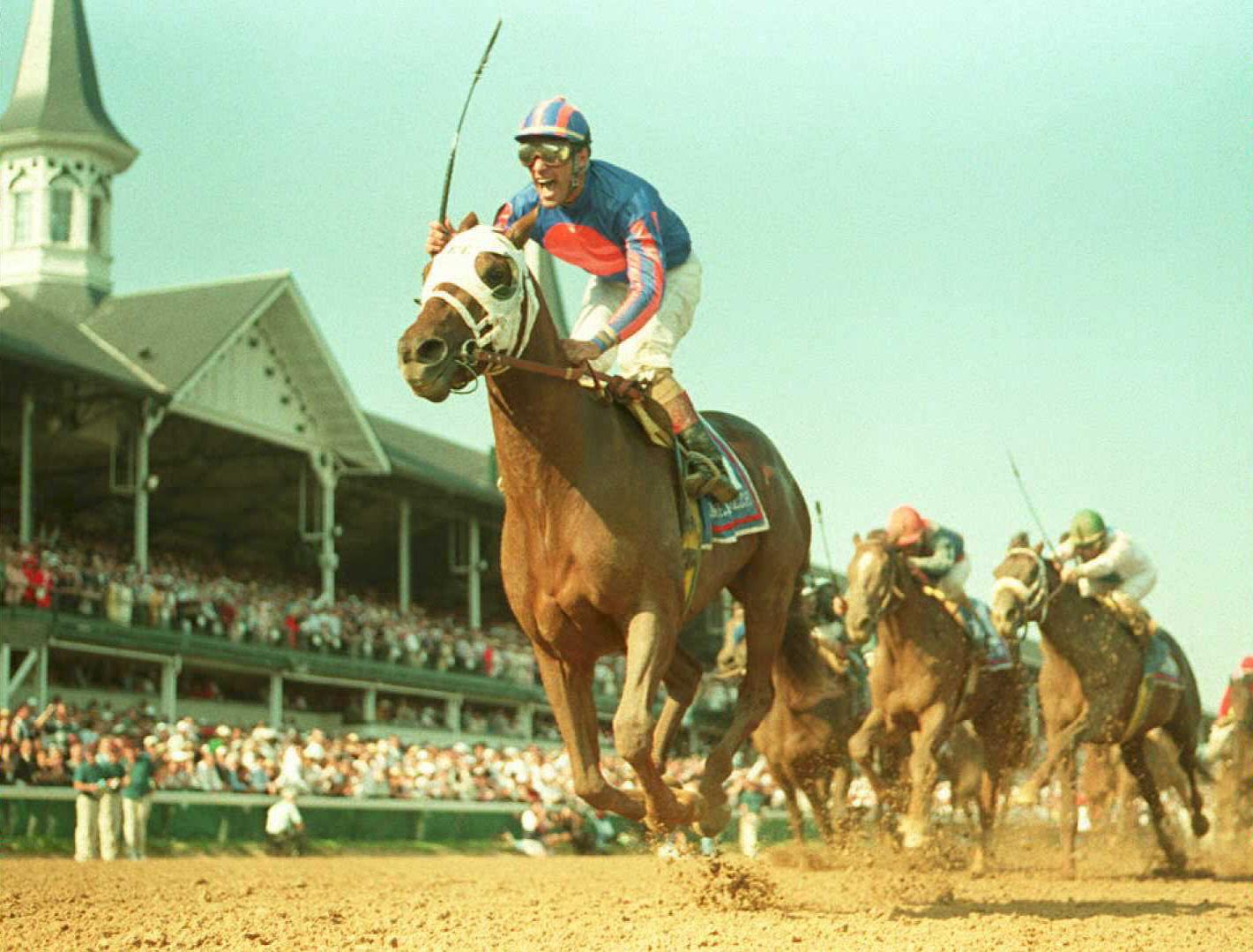 Jockey Gary Stevens(L) rides Thunder Gulch horse
