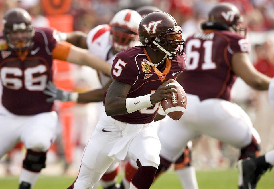 Marcus Vick #5 of the Virginia Tech Hokies scrambles against the Louisville Cardinals