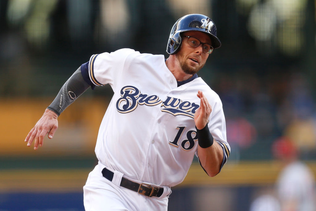 Eric Sogard #18 of the Milwaukee Brewers reaches home plate