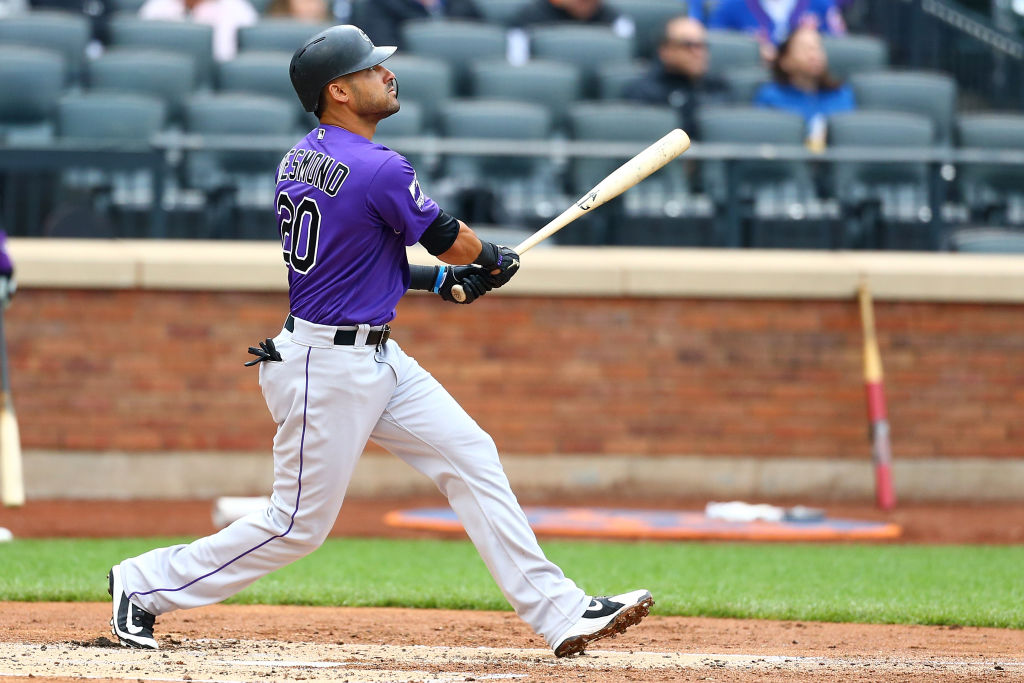 Ian Desmond #20 of the Colorado Rockies connects on a solo home run