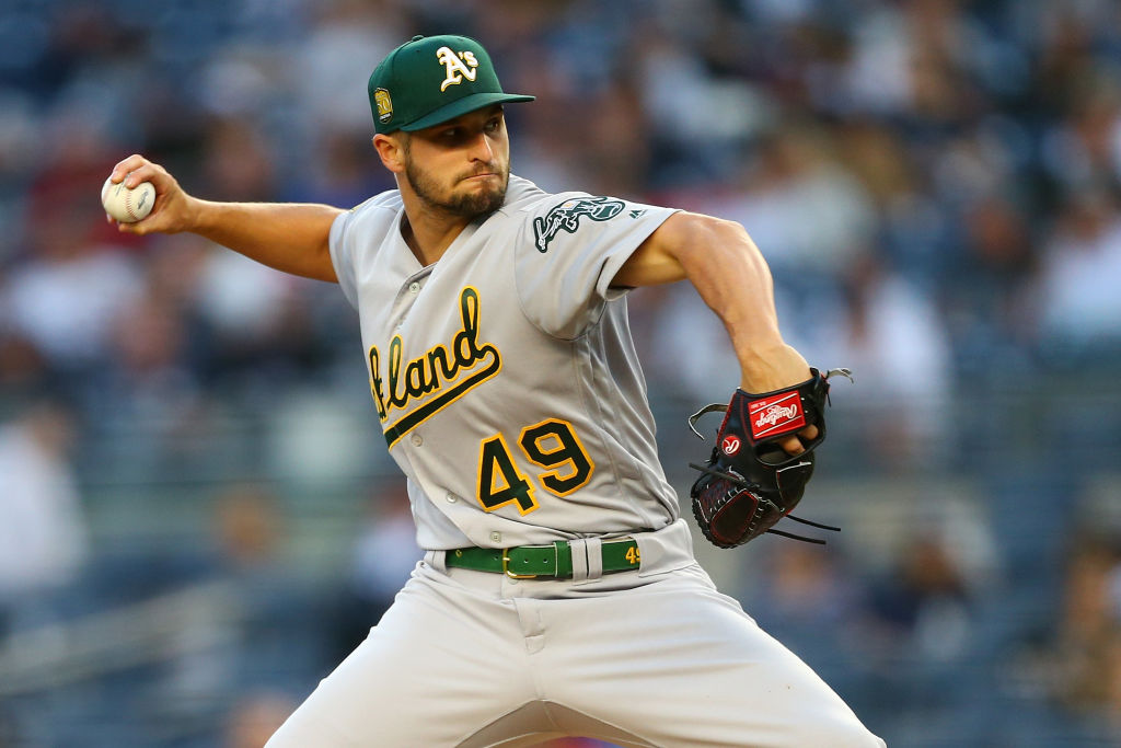 Kendall Graveman #49 of the Oakland Athletics pitches