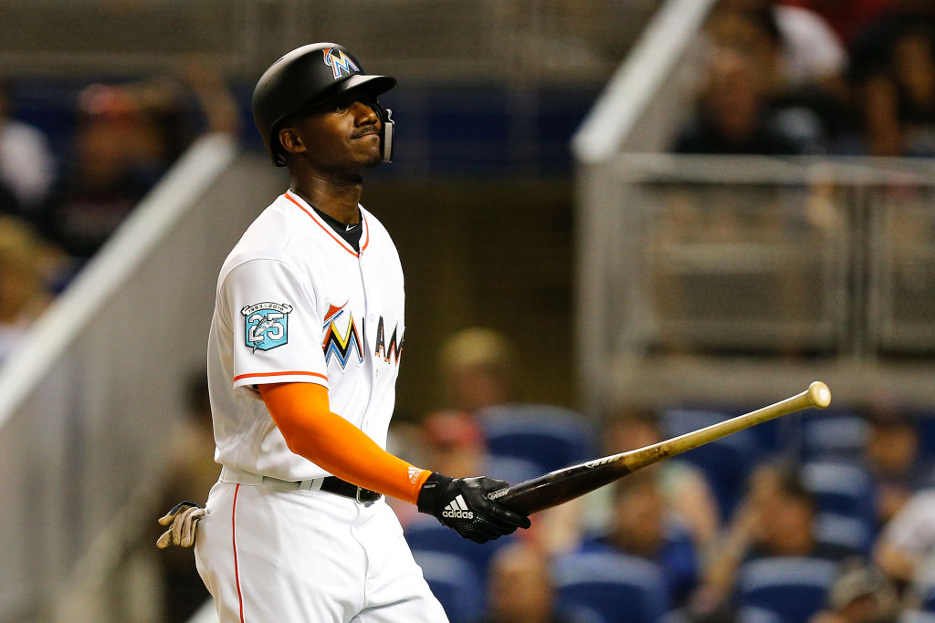 Lewis Brinson #9 of the Miami Marlins reacts after striking out
