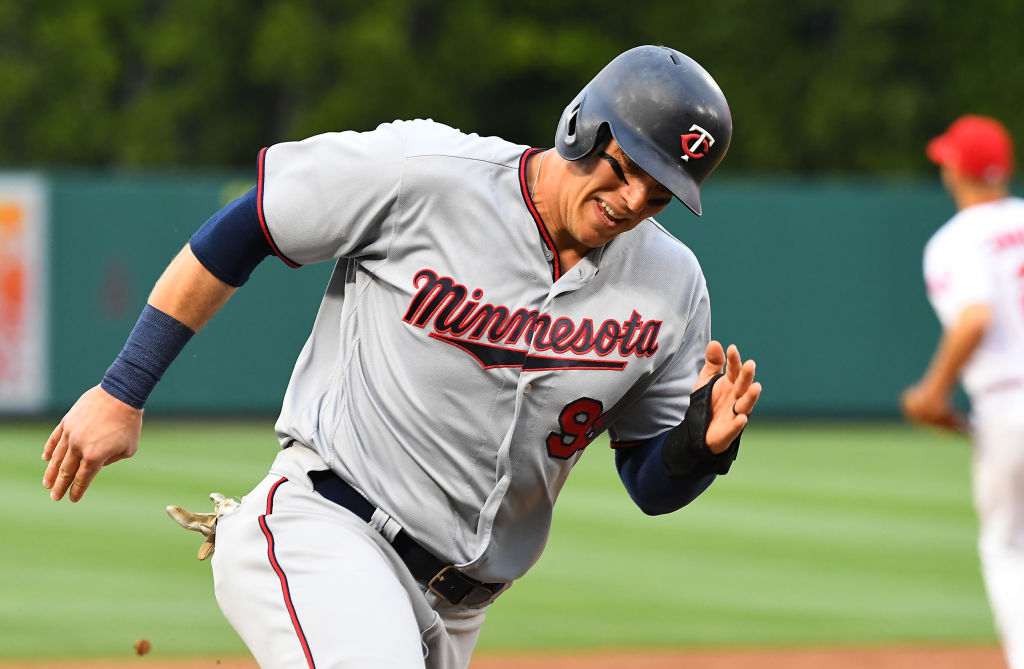Logan Morrison #99 of the Minnesota Twins rounds third base