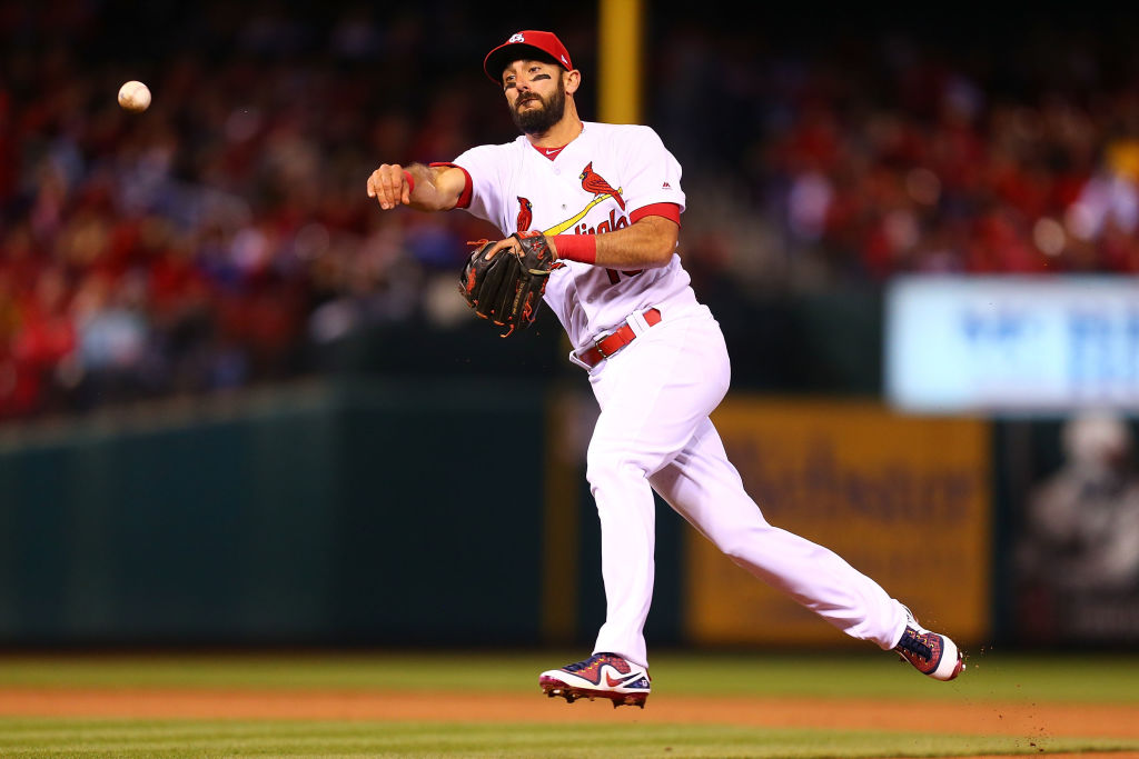 Matt Carpenter #13 of the St. Louis Cardinals throws a runner out