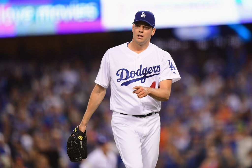 Rich Hill #44 of the Los Angeles Dodgers reacts during the second inning