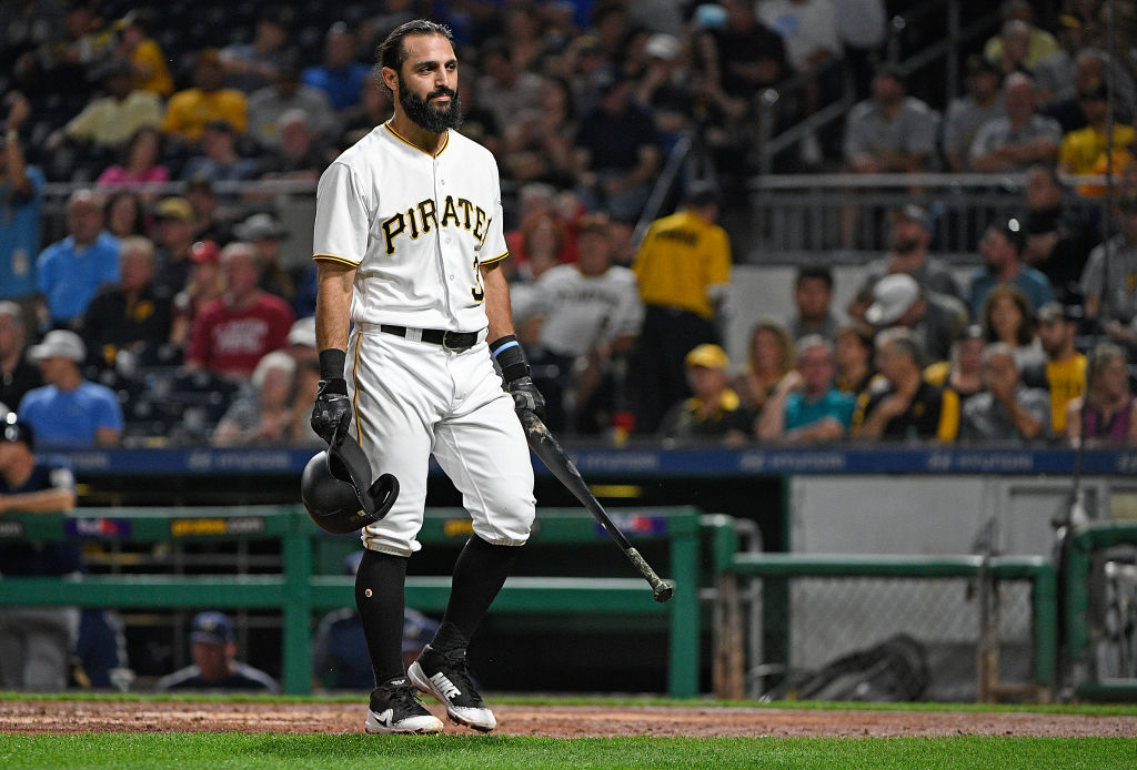 Sean Rodriguez #3 of the Pittsburgh Pirates walks back to the dugout after striking out