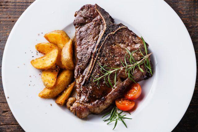 Steak on a white plate.