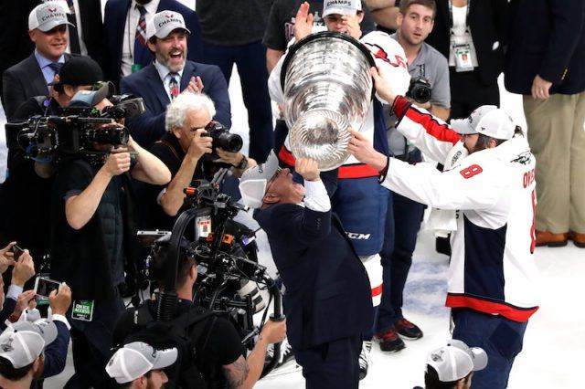 Alex Ovechkin holding up the cup.