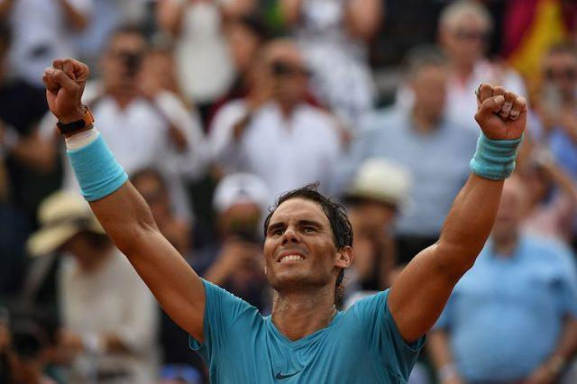 Rafael Nadal celebrates after victory over Austria's Dominic Thiem during their men's singles final match on day fifteen of The Roland Garros 2018 French Open tennis tournament in Paris.