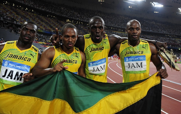 "Jamaica's Nesta Carter, Michael Frater, Usain Bolt and Asafa Powell celebrate after winning the men's 4?100m relay final at the ""Bird's Nest"" National Stadium during the 2008 Beijing Olympic Games on August 22, 2008."