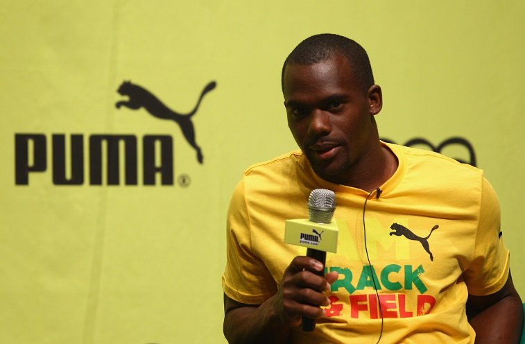 Nesta Carter of Jamaica talks to the media during the PUMA - JAAA press conference prior to the IAAF World Athletics Championships at the Daeduk Cultural Hall on August 25, 2011 in Daegu, South Korea.