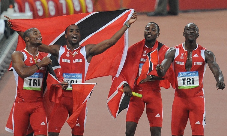 Trinidad and Tobago's Keston Bledman, Emmanuel Callender, Richard Thompson and Marc Burns celebrate after winning silver in the men's 4x100m Relay final at the National Stadium during the 2008 Beijing Olympic Games on August 22, 2008.