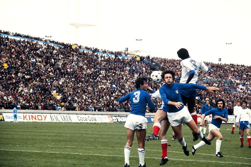 Antonio Cabrini (left) defends for Italy's soccer team