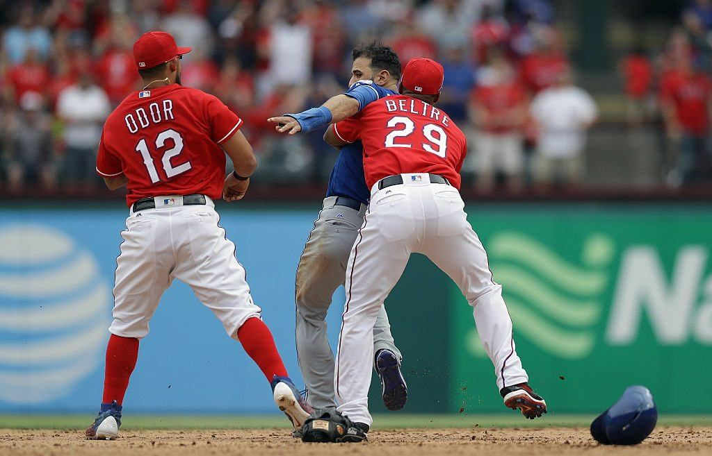 Adrian Beltre holds Jose Bautista back after Rougned Odor punches him