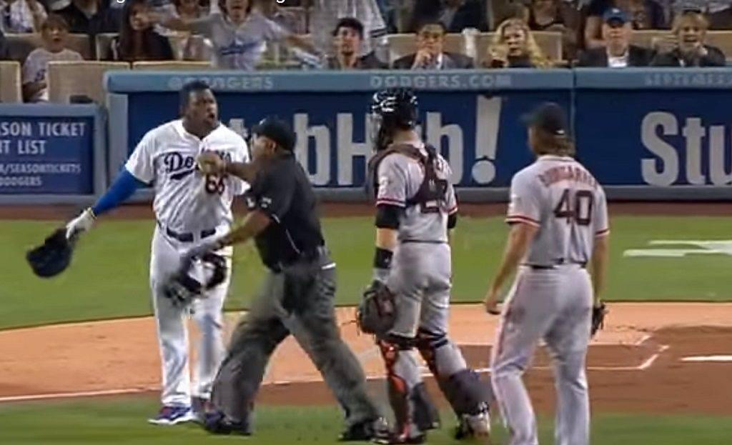 Yasiel Puig tries charging at pitcher Madison Bumgarner