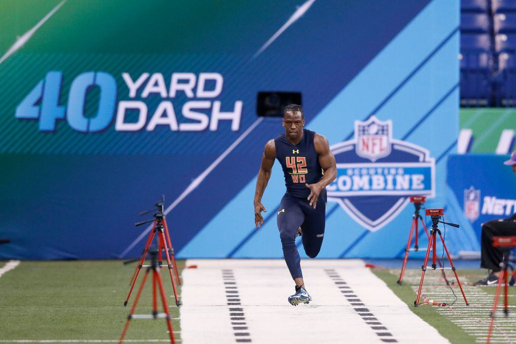John Ross of the University of Washington runs the 40-yard dash at the NFL combine