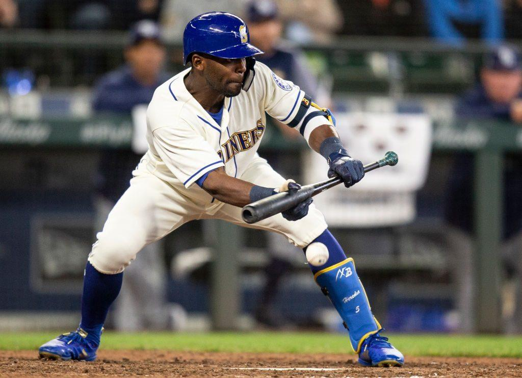 Seattle Mariners outfielder Guillermo Heredia squares up to lay down a sacrifice bunt