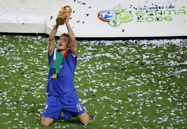 Italian midfielder Francesco Totti celebrates with the trophy after the World Cup 2006 final football game