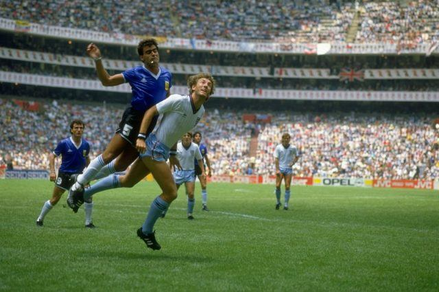 Jose-Luis Brown of Argentina tangles with Terry Butcher of England during the World Cup quarter-final in 1986
