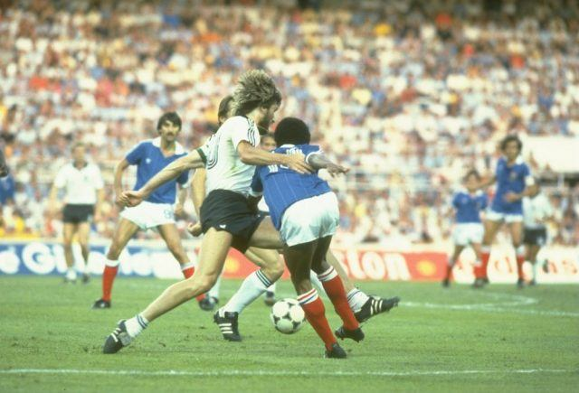 Manni Kaltz (left) of West Germany tackles Jean Tigana (right) of France for the ball during the World Cup Semi Finals match in 1982