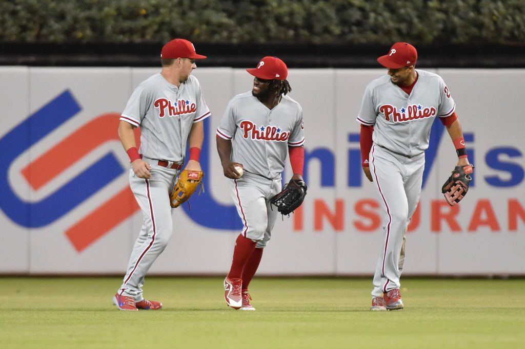Philadelphia Phillies outfielders (from left) Rhys Hoskins, Odubel Herrera, and Aaron Altherr