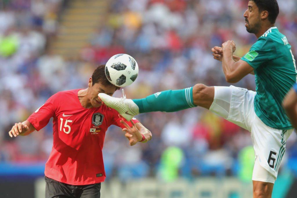 Sami Khedira of Germany is challenged by Wooyoung Jung of Korea Republic during the 2018 FIFA World Cup