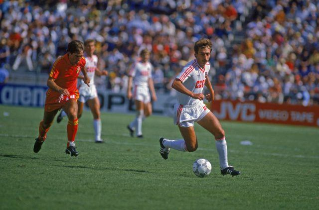 Sergei Aleinikov of the Soviet Union (right) is pursued by Daniel Veyt of Belgium in their World Cup second round match in 1986