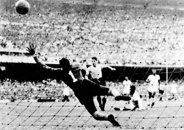 Uruguayan Juan 'Pepe' Schiaffino (C) scores the first goal against Brazil, during the1950 World Cup