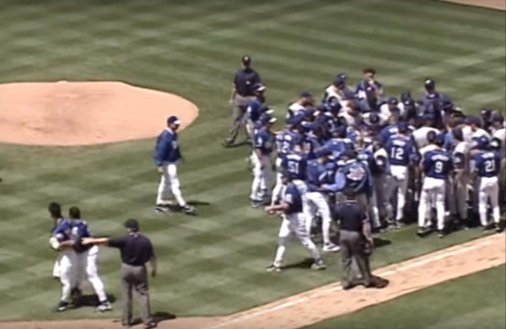 Pitcher Chan Ho Park (bottom left) is escorted away from a bench-clearing brawl he started with Tim Belcher