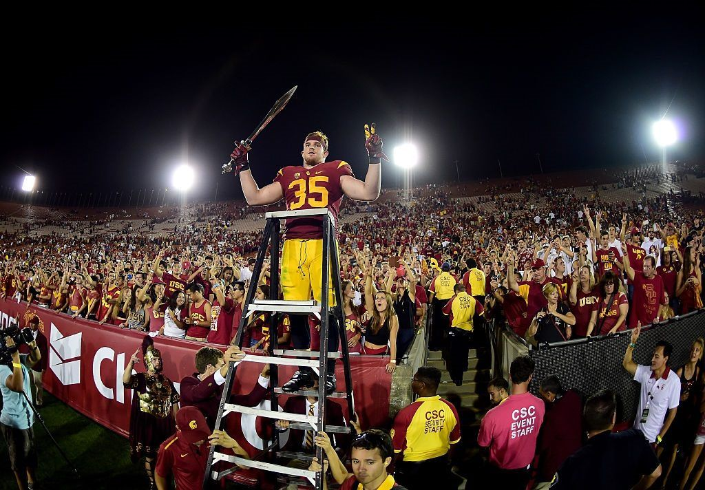 Cameron Smith leads Trojans fans in celebration after a USC victory