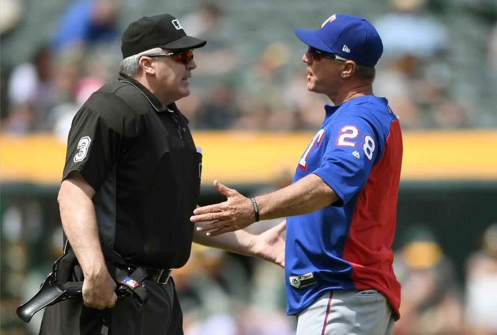 Manager Jeff Banister of the Texas Rangers argues with home plate umpire Bill Welke