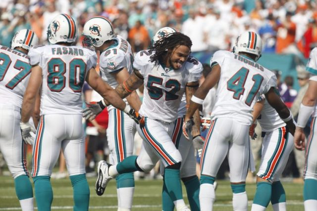 Channing Crowder and Dolphins teammates