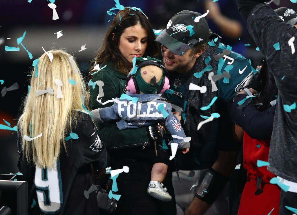 Nick Foles of the Philadelphia Eagles celebrates defeating the New England Patriots 41-33 with his wife Tori