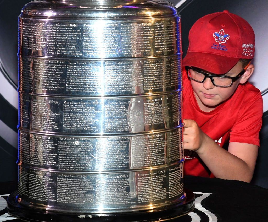 A young fan gets an up-close look at the Stanley Cup