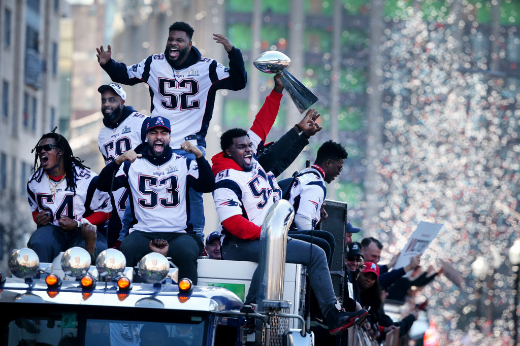 New England Patriots players Dont'a Hightower (54), Albert McClellan (59) ,Elandon Roberts (52) , Kyle Van Noy (53) and Ja'Whaun Bentley (51) enjoy the 2019 Super Bowl victory parade