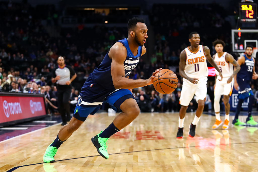 NBA guard Josh Okogie dribbles the ball.