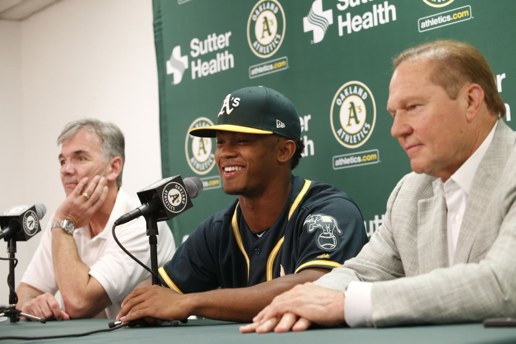 Other NFL players before Kyler Murray (center) turned down a baseball careers