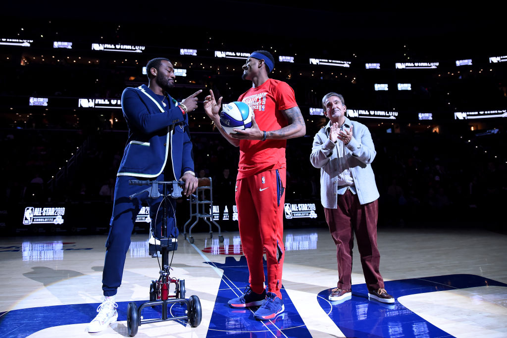 Gilbert Arenas says the Washington Wizards need to be concerned about the future of John Wall (left) given his injury history.