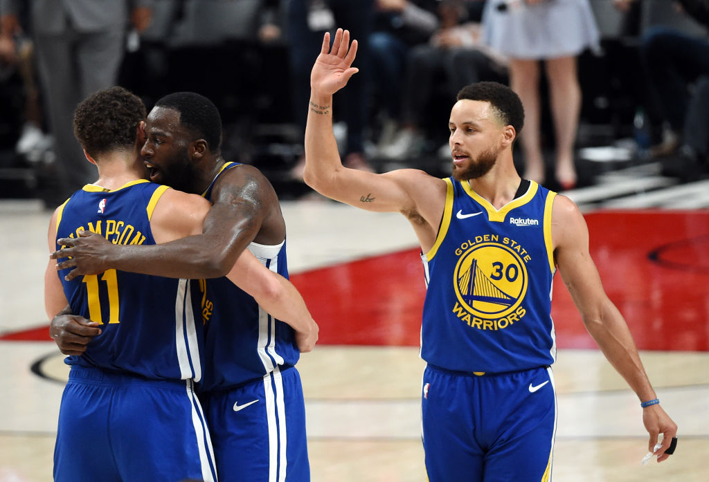 Who might join Stephen Curry (right) and Draymond Green (center) in the Golden State Warriors lineup in 2019-20?