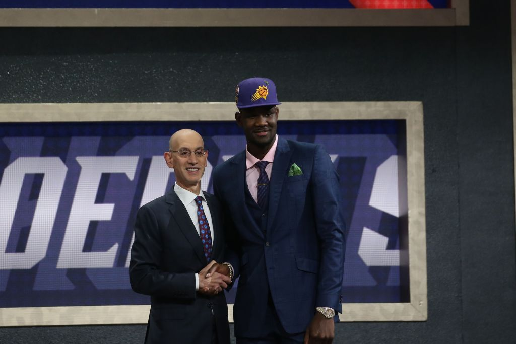 Adam Silver (left) and Deandre Ayton at the 2018 NBA draft. Don't expect any insane trade offers from teams looking to move up and draft Zion Williamson 2019.