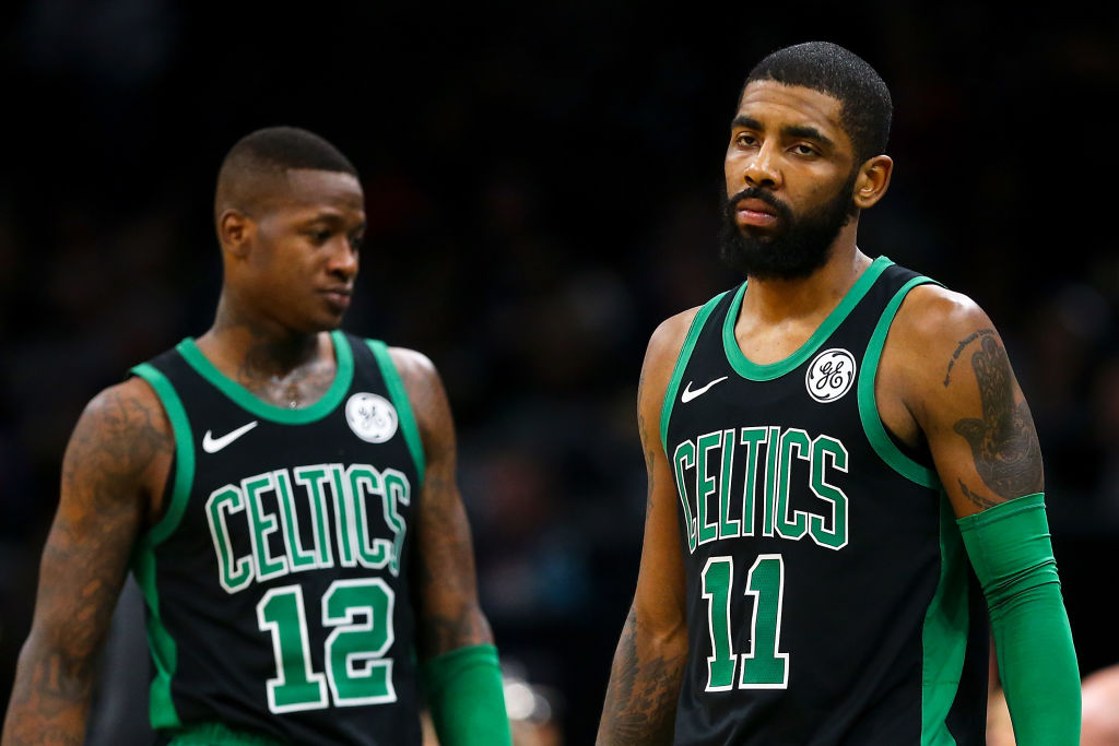 Terry Rozier (left) sounds like he wants to leave the Celtics behind, especially if Kyrie Irving stays.